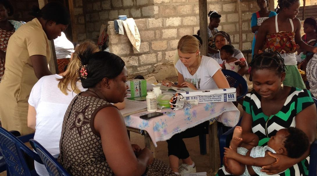 Local women attend a community outreach and receive treatment from Projects Abroad Midwifery and other medical interns in Ghana.